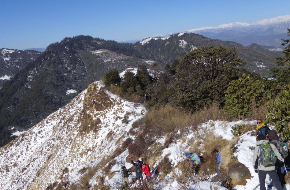 Hikers Going Down a Steeper Portion of the Trail in Nepal