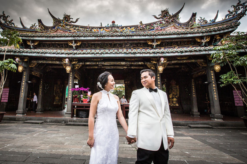 Nadia in a White Dress Being Led by the Hand by JM in a Black and White Tuxedo at Lungshan Temple By Ching Hua Bridal Art
