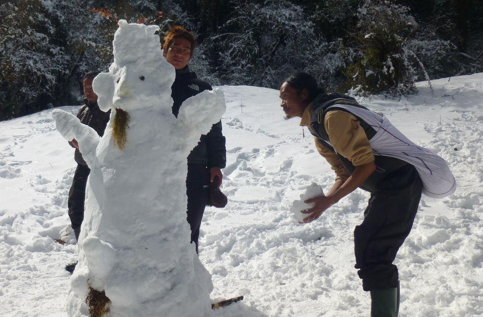 People Making a Snow Goat Sculpture in Nepal