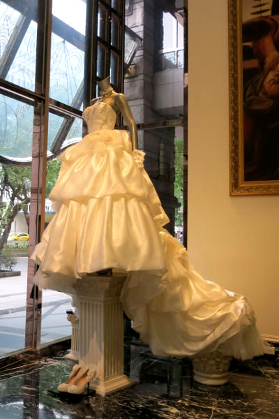 Ching Hua Bridal Art Wedding Dress on a Pedestal Just Within the Entrance