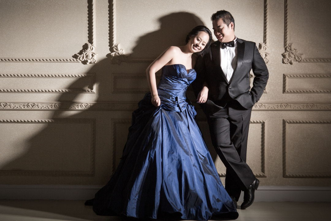 Nadia in a Dark Blue Wedding Dress Arm in Arm with JM in a Black Tuxedo by Ching Hua Bridal Art