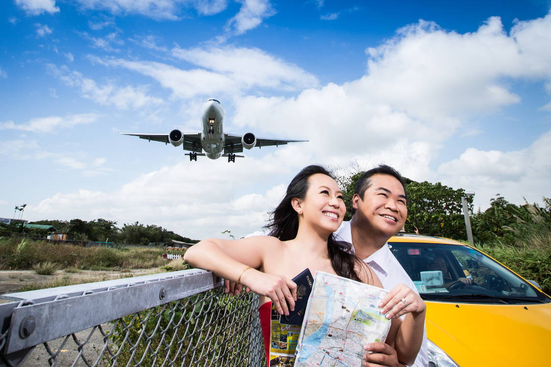 Nadia and JM Posing By a Cab with a Map Below a Plane at Taipei Songshan Airport By Ching Hua