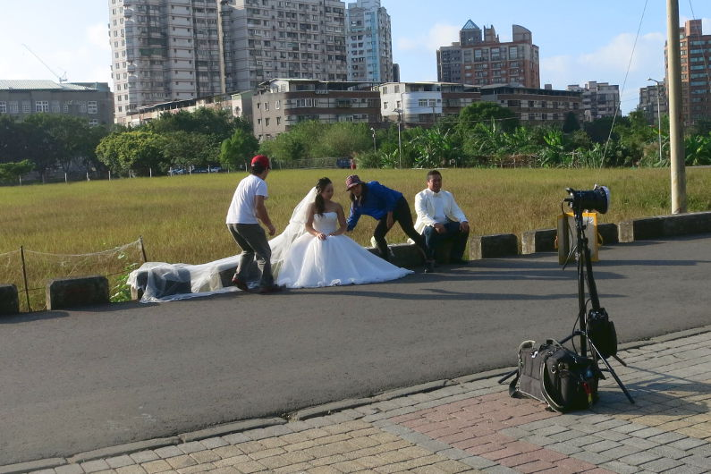 Ching Hua Bridal Art Behind the Scenes at the Grass Area with Nadia and JM Getting Touched Up Between Photos