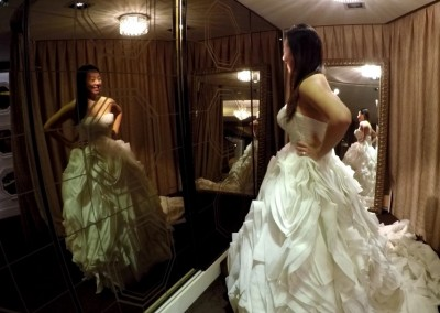 Ching Hua Bridal Art Behind the Scenes Wedding Dress Selection with Nadia in a Different White Dress Looking at Her Reflection