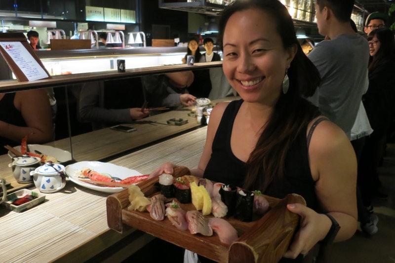 Nadia Holding a Tray of Sushi at Addiction Aquatic Development Taipei