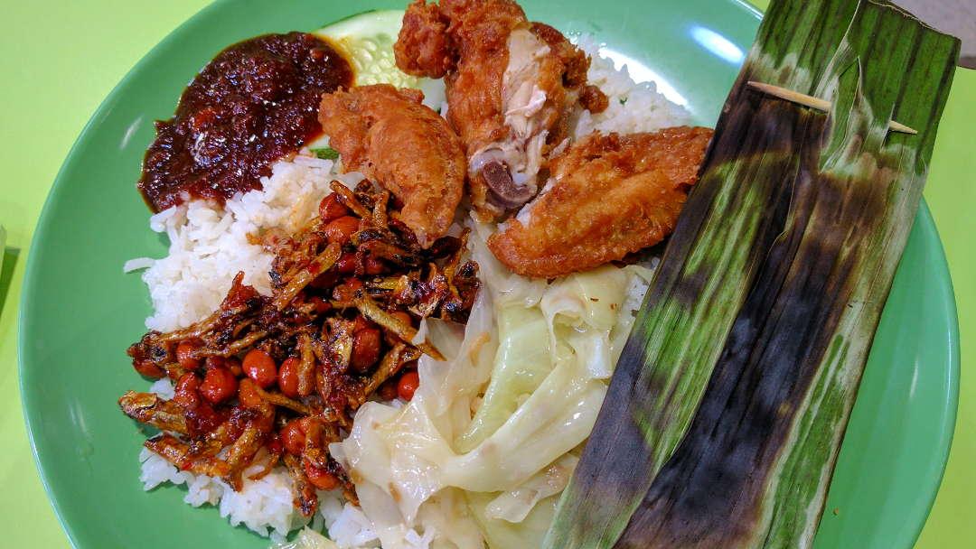 Nasi Lemak Malaysian Breakfast with Ikan Bilis Fried Chicken Otak Coconut Pandan Rice Sambal Sauce