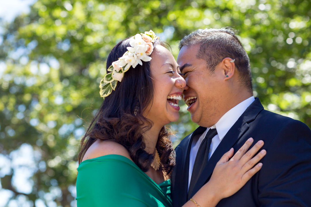 JM and Nadia laughing while holding each other in Los Gatos Vasona Park