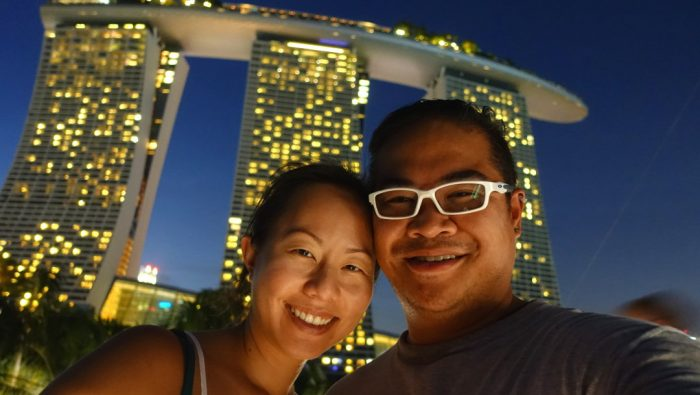 JM and Nadia posing in front of the Marina Bay Sands Hotel Singapore