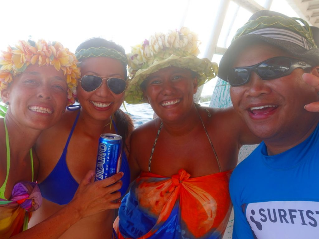 JM and Nadia posing with friends in Huahine