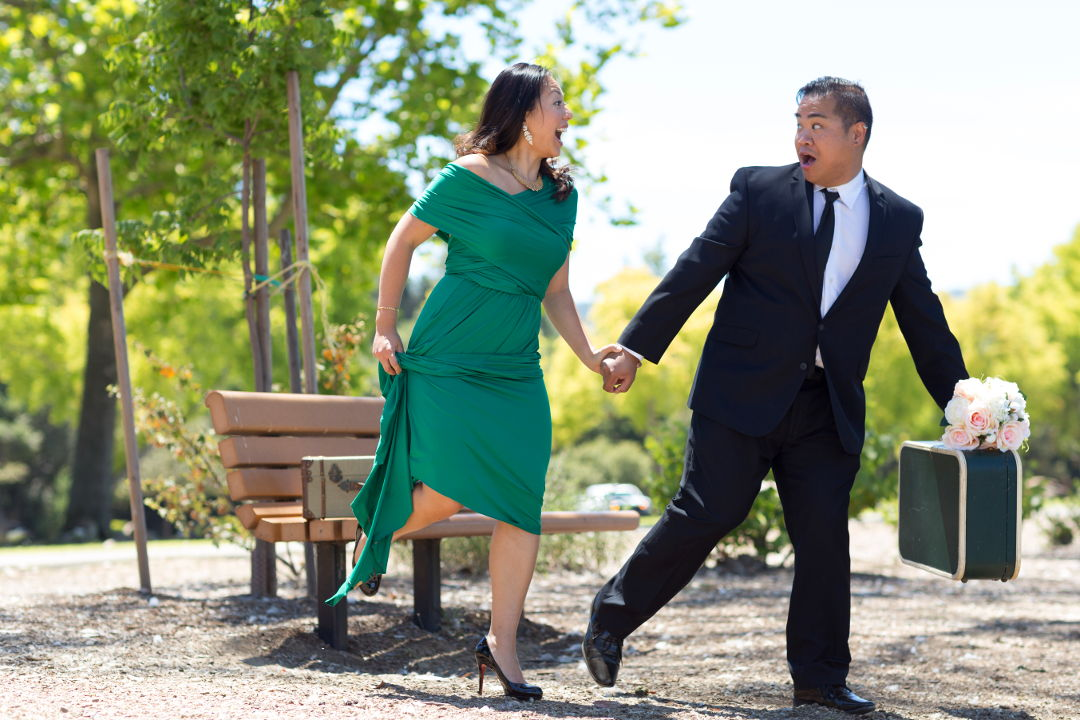 JM and Nadia running away with suitcases and flowers in Los Gatos Vasona Park 02