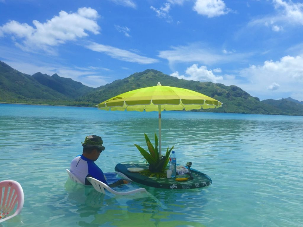 JM sitting in the water waiting for lunch in Huahine