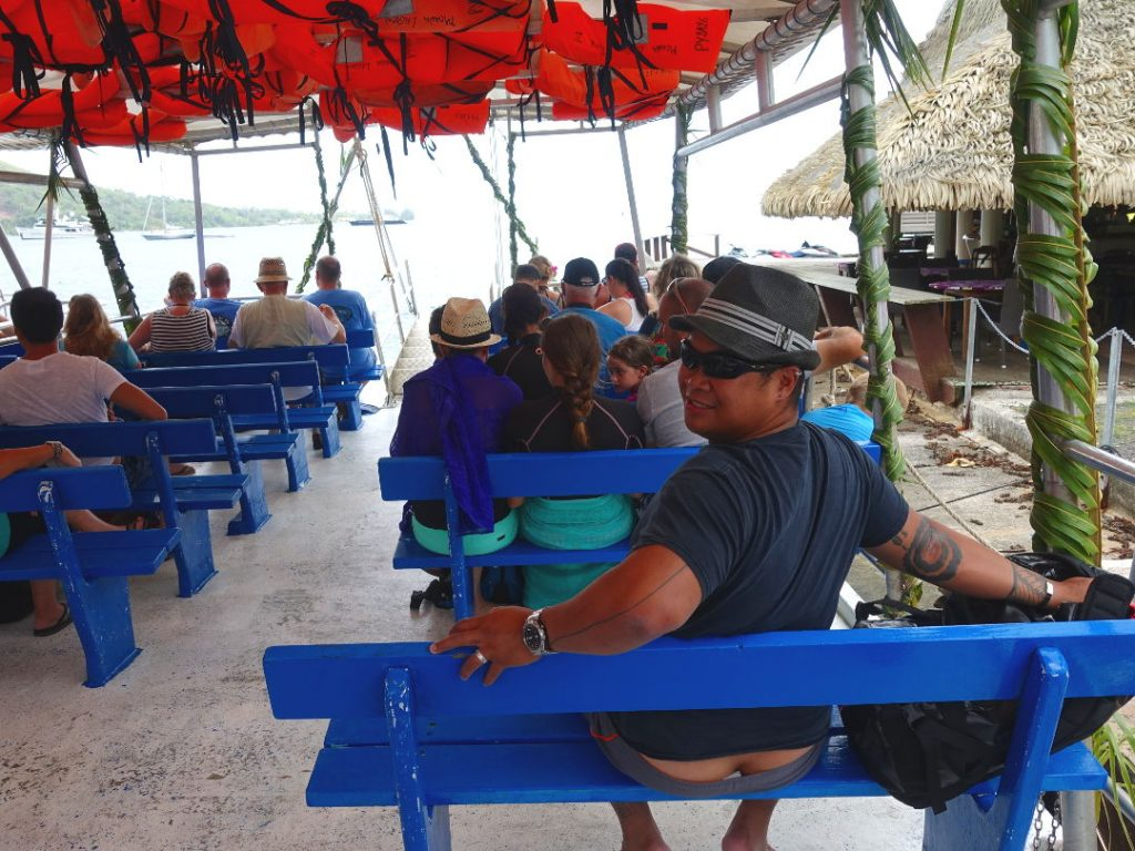 JM waiting for the tour boat to depart to snorkel in Moorea
