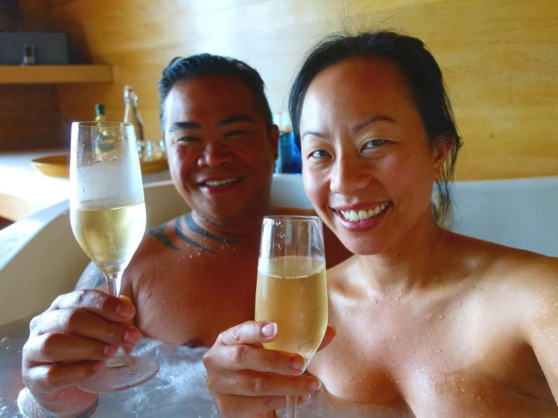 Nadia and JM drinking champagne in the spa at Conrad Maldives