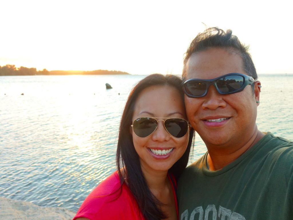 Nadia and JM during sunset at the beach in Moorea