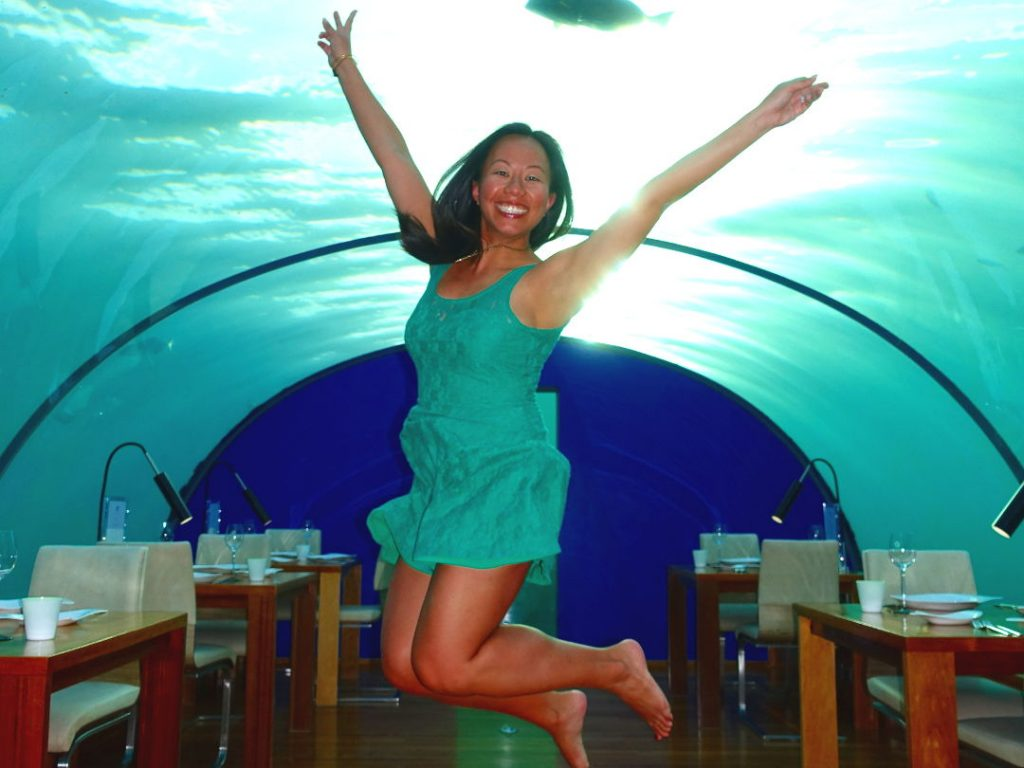 Nadia in mid jump in the underwater Ithaa Restaurant at the Conrad Maldives
