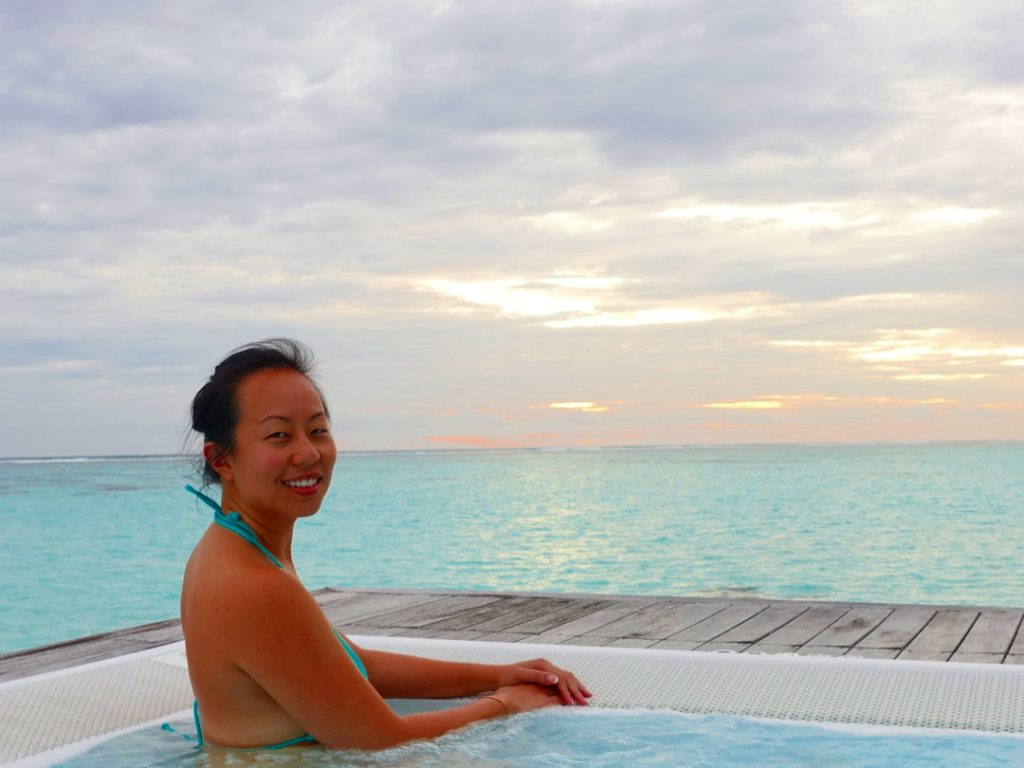 Nadia in the above water spa during sunset at the Conrad Maldives