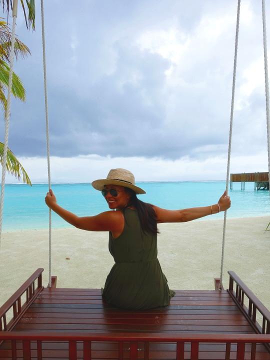 Nadia on a swing on the beach at the Conrad Maldives