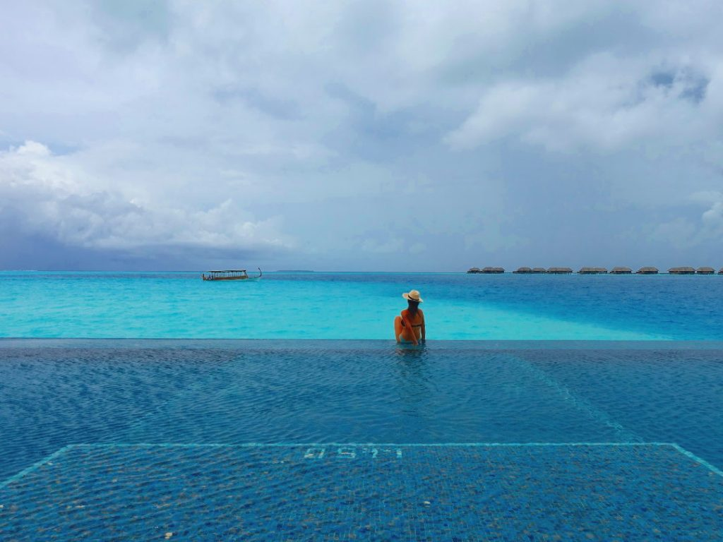Nadia Sitting on the Edge of the Adult Only Pool at the Conrad Maldives
