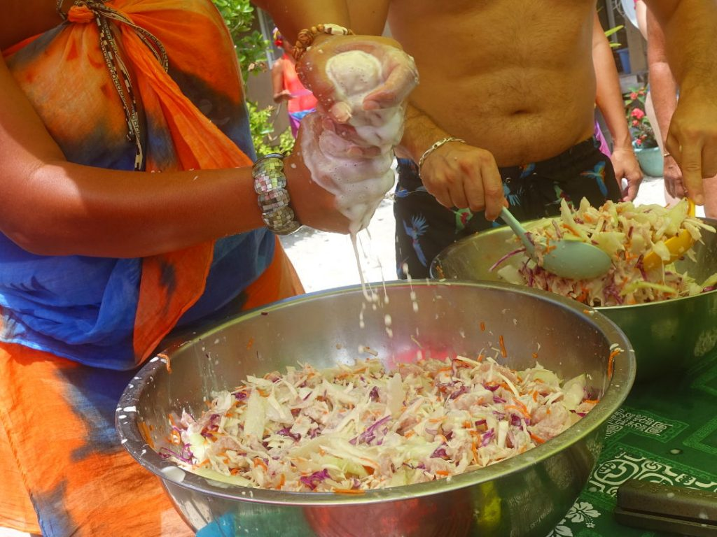 Salad being made on the beach with hand squeezed coconut milk in Huahine