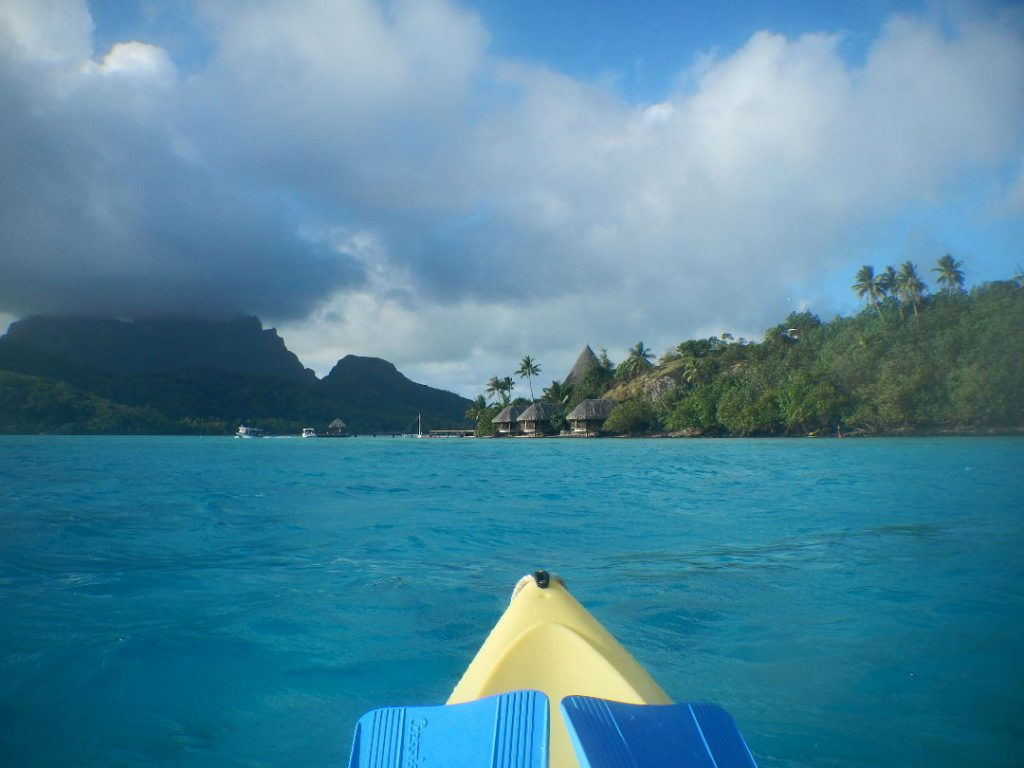 Stormy weather ahead while kayaking and snorkeling in the ocean Bora Bora
