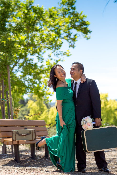 jm and nadia posing with suitcases and flowers Los Gatos Vasona Park 02