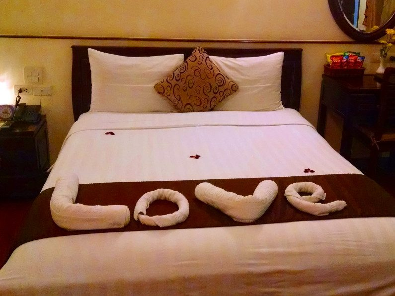 Bed with Love Spelled with Towels at the Charming 2 Hotel Hanoi