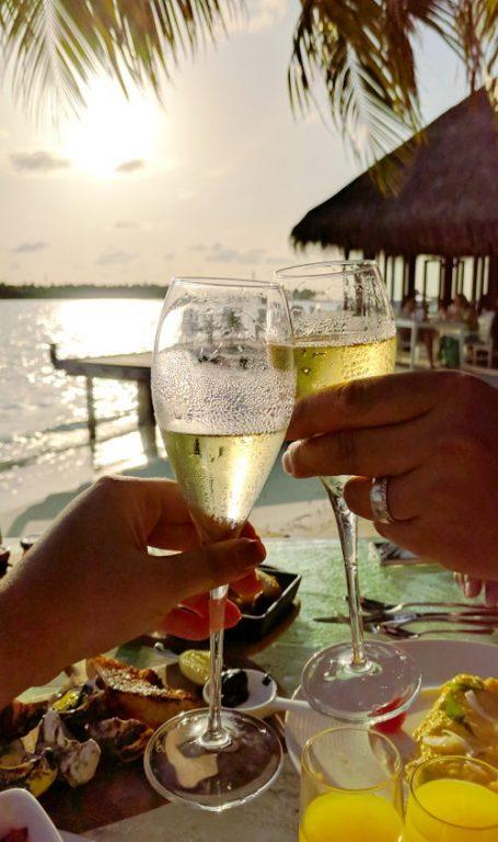 Nadia and JM Enjoying Conrad Maldives Champagne Breakfast
