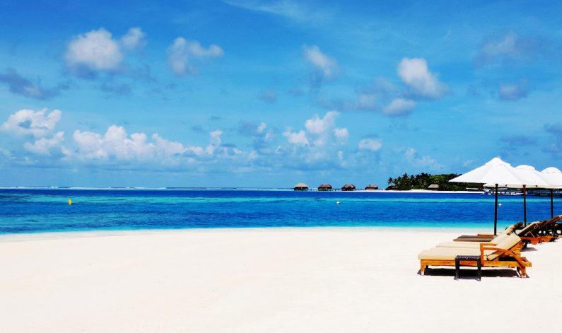 Sunny Day Beach side at the Conrad Maldives