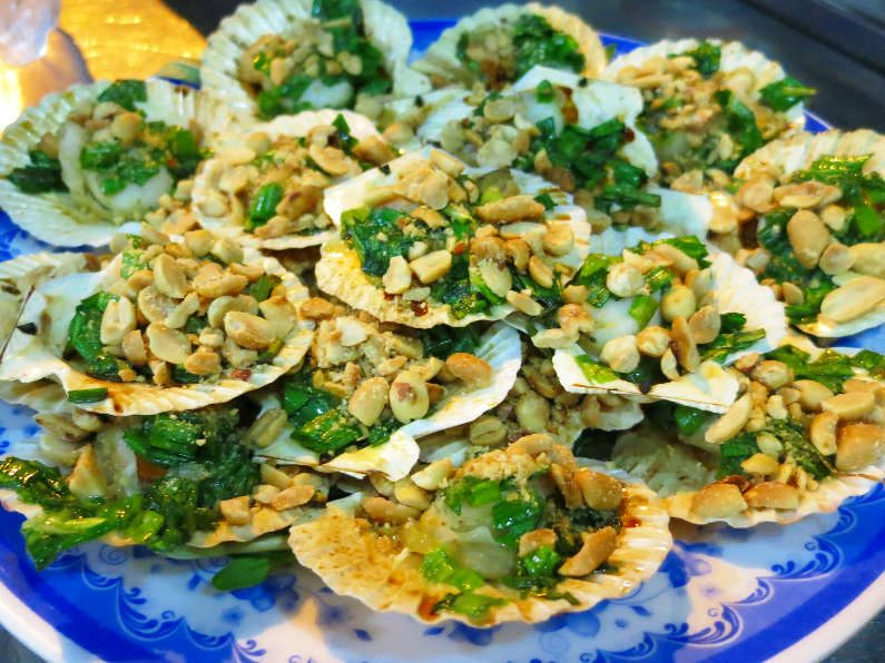 Plate Full of Peanut Topped Clams During XO Tours Saigon