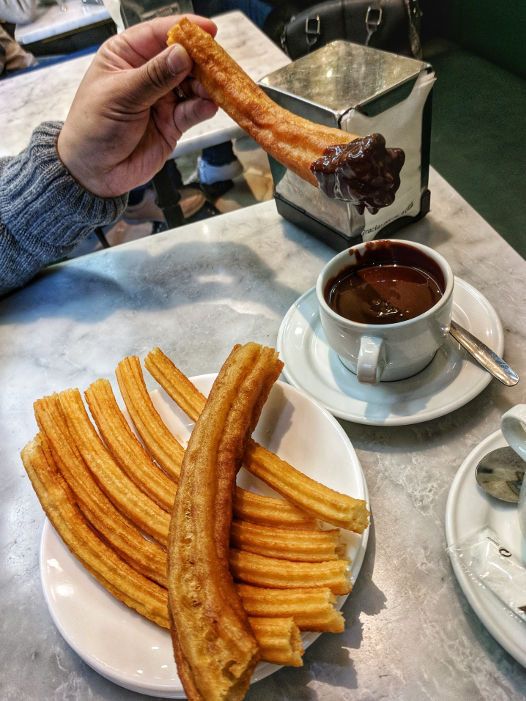 Freshly Made Churros Dipped in Chocolate at Choclateria San Gines