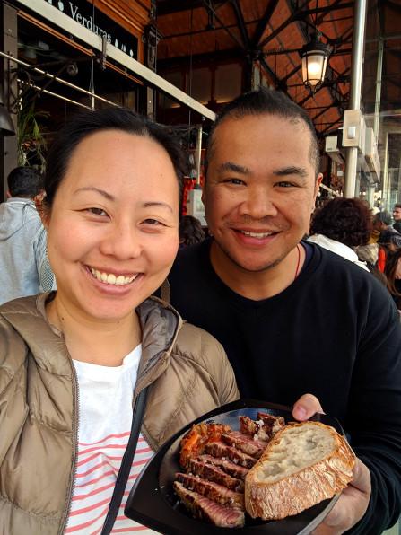 San Miguel Market Nadia and JM Eating Steak