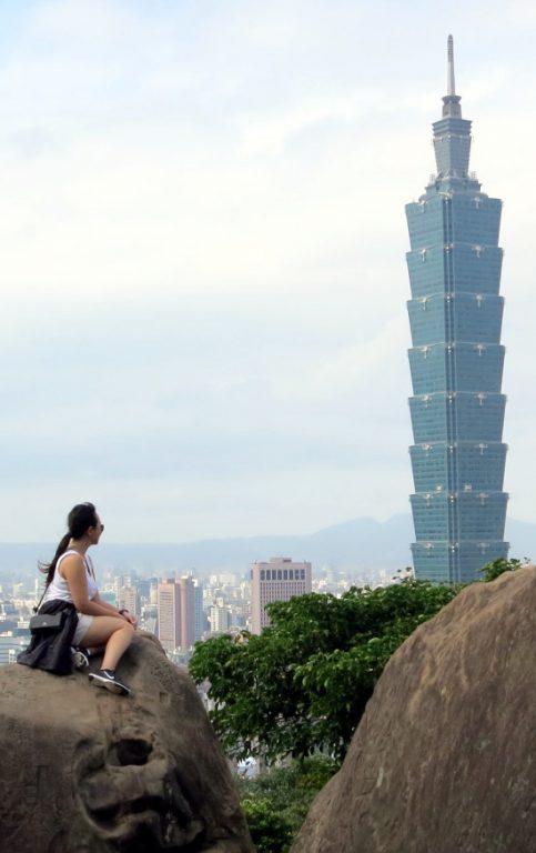 Nadia on the Rock staring at Taipei 101
